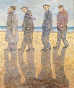 Quattro uomini sulla spiaggia